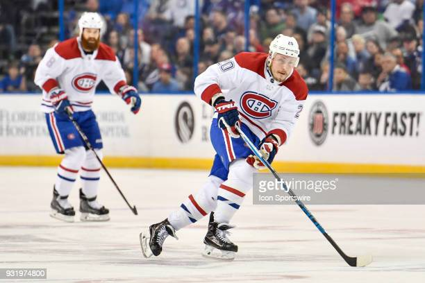 Montreal Canadiens left wing Nicolas Deslauriers skates the puck through the neutral zone during the first period of an NHL game between the Montreal...