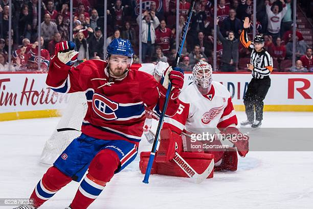 Montreal Canadiens left wing Paul Byron celebrates after scoring his team second goal during the first period of the NHL regular season game between...