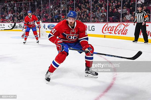 Montreal Canadiens Left Wing Paul Byron looking at the puck in the corner during the Minnesota Wild versus the Montreal Canadiens game on December 22...