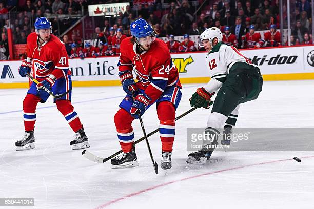 Montreal Canadiens Left Wing Phillip Danault looking at the puck getting away while Minnesota Wild Center Eric Staal passes behind him during the...