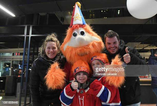 Montreal Canadiens mascot Youppi poses to a photo with fans on his 40th birthday prior to the NHL game between the Montreal Canadiens and the...