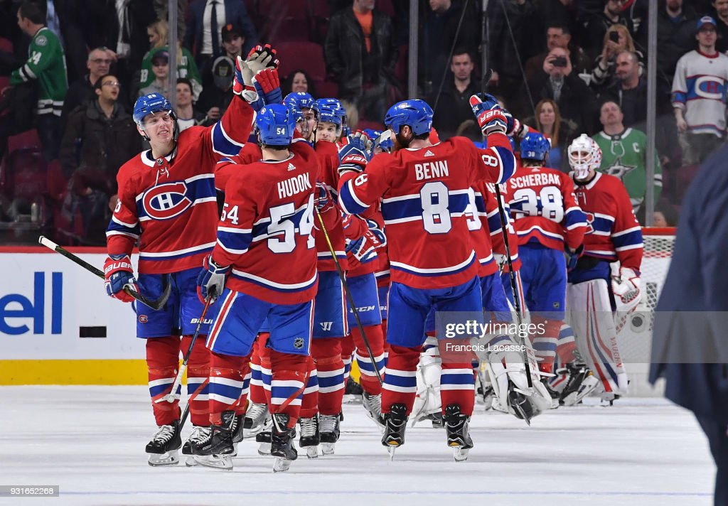 Montreal Canadiens' players celebrate after defeating the Dallas Stars in the NHL game at the Bell Centre on March 13, 2018 in Montreal, Quebec, Canada.