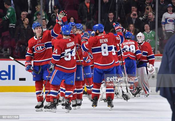 Montreal Canadiens' players celebrate after defeating the Dallas Stars in the NHL game at the Bell Centre on March 13 2018 in Montreal Quebec Canada