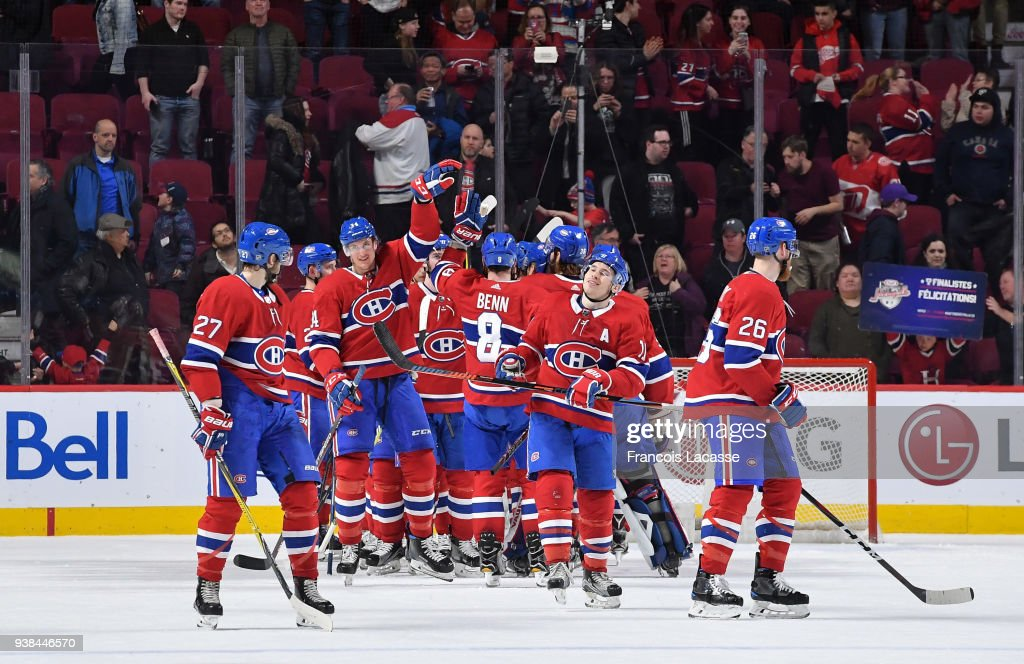 Montreal Canadiens' players celebrate after defeating the Detroit Red Wings in the NHL game at the Bell Centre on March 26, 2018 in Montreal, Quebec, Canada.