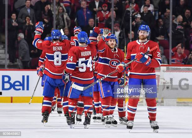 Montreal Canadiens' players celebrate after defeating the New York Islanders in the NHL game at the Bell Centre on February 28 2018 in Montreal...