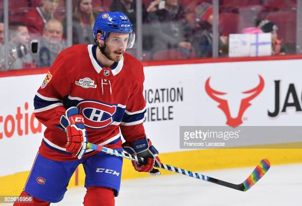 Montreal Canadiens' players including Victor Mete use rainbowcolored Pride tape on their sticks during the pregame warmup period as part of the NHL's...