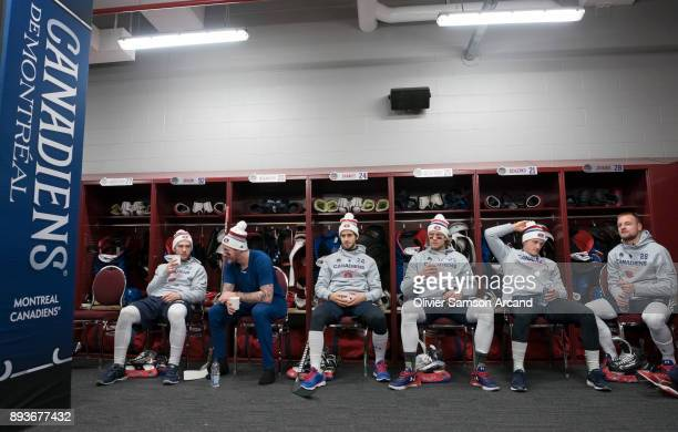 Montreal Canadiens players sit in their locker room prior to practice ahead of the Scotiabank NHL 100 Classic at Lansdowne Park on December 15 2017...
