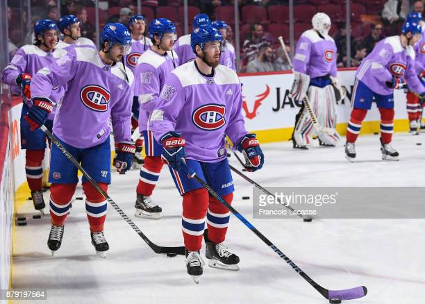 Montreal Canadiens players wear lavender jersey during warm up to support Hockey Fights Cancer campaign prior to the game against the Buffalo Sabres...