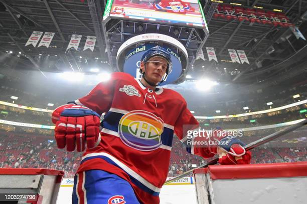 Montreal Canadiens' players wear rainbowcolored jerseys for the 'Hockey is for Everyone Night' prior to the NHL game against the Vancouver Canucks at...
