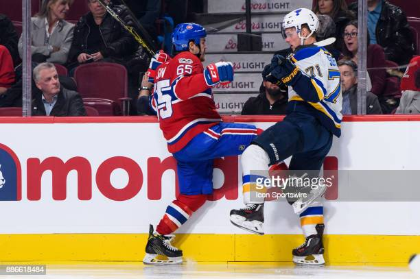 Montreal Canadiens right wing Andrew Shaw collides with St Louis Blues left wing Vladimir Sobotka during the second period of the NHL game between...