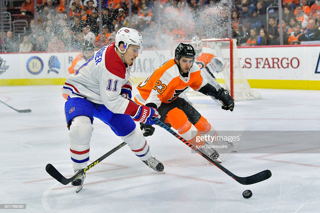 Montreal Canadiens right wing Brendan Gallagher (11) and Philadelphia Flyers defenseman Brandon Manning (23) vie for the puck during the NHL game between the Montreal Canadiens and the Philadelphia Flyers on February 20, 2018 at the Wells Fargo Center in Philadelphia PA.