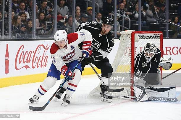 Montreal Canadiens Right Wing Brendan Gallagher attempts to pass the puck past Los Angeles Kings Defenceman Alec Martinez during the game on December...