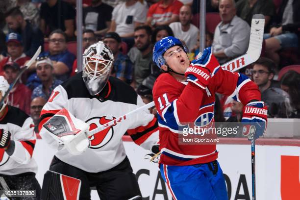 Montreal Canadiens right wing Brendan Gallagher gets caught by the high stick of New Jersey Devils goaltender Eddie Lack during the first period of...