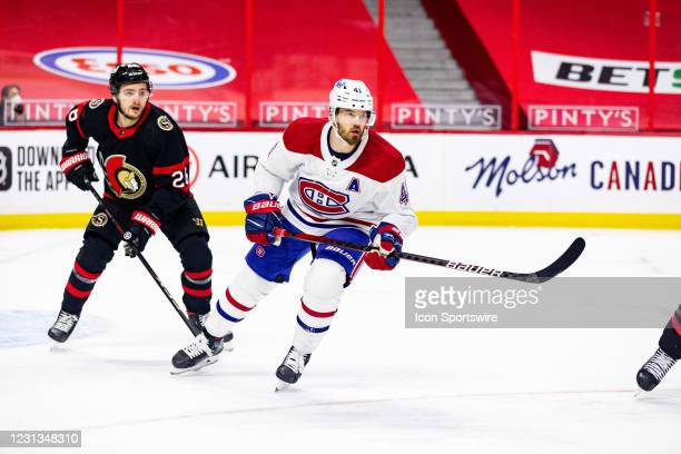 Montreal Canadiens Right Wing Paul Byron follows the play with Ottawa Senators Defenceman Erik Brannstrom close behind during first period National...