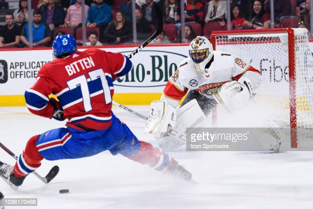 Montreal Canadiens right wing Will Bitten trips in front of Florida Panthers goaltender Roberto Luongo during the second period of the NHL preseason...