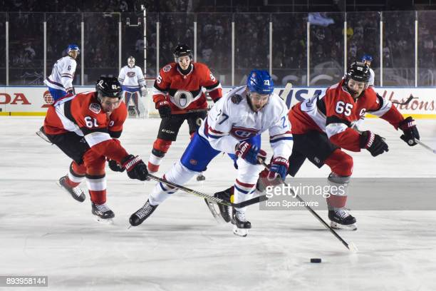 Montreal Canadiens Winger Alex Galchenyuk reaches to the puck while Ottawa Senators Right Wing Mark Stone tries to stop him during the Montreal...