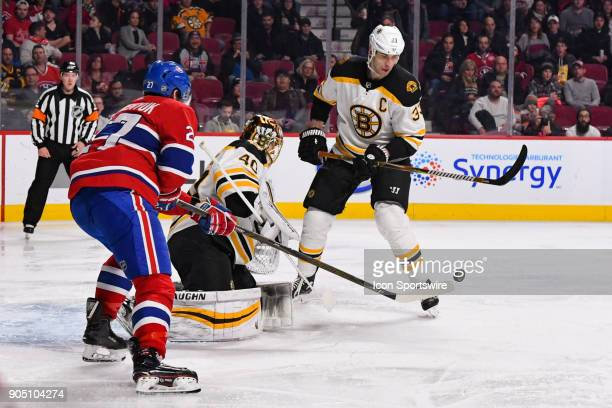 Montreal Canadiens Winger Alex Galchenyuk tries to touch a loose puck in the air in front of Boston Bruins Goalie Tuukka Rask during the Boston...