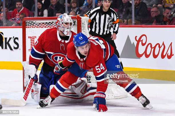 Montreal Canadiens Winger Charles Hudon falls low in front of Montreal Canadiens Goalie Antti Niemi while tracking the play during the Pittsburgh...