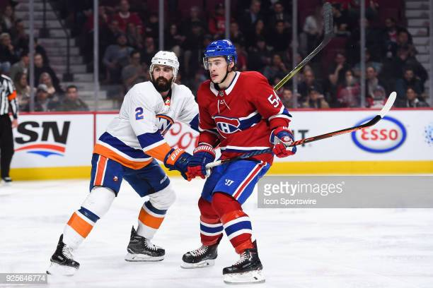 Montreal Canadiens Winger Charles Hudon skates towards the net while New York Islanders Defenceman Nick Leddy pushes him away during the New York...