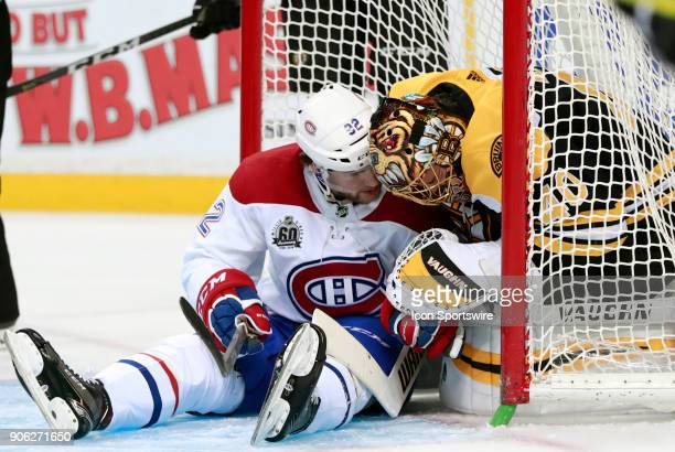 Montreal Canadiens winger Jonathan Drouin checks with Boston Bruins goalie Tuukka Rask after crashing into him during a game between the Boston...