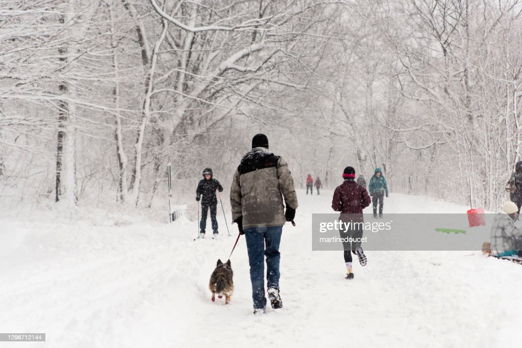 Montreal city park with people enjoying snow storm. : Stock Photo