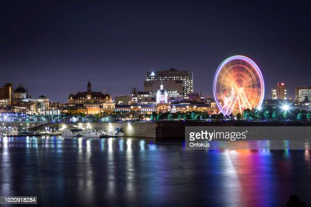montreal cityscape in summer at night - vieux montréal stock pictures, royalty-free photos & images