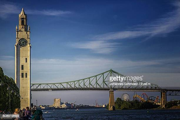 Montreal Clock Tower And Bridge Over St Lawrence River