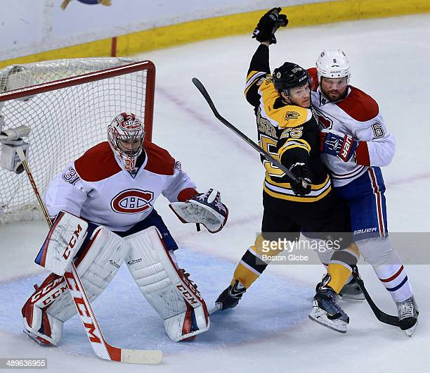 Montreal defenseman Douglas Murray stands up the Bruins' Matt Fraser in front of Canadiens goalie Carey price in the second period The Boston Bruins...