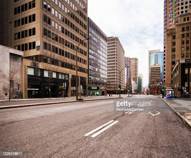 montreal deserted boulevard rené-lévesque during covid 19 crisis - financial district stock pictures, royalty-free photos & images