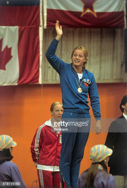 East Germany's swimmer Kornelia Ender waves from victory stand after she won 7/22 her 4th Gold Medal for her victory in women's 200meter freestyle