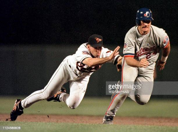 Montreal Expos base runner Darrin Fletcher attempts to out run Baltimore Orioles shortstop Mike Bordick in the eighth inning in Baltimore 16 June...