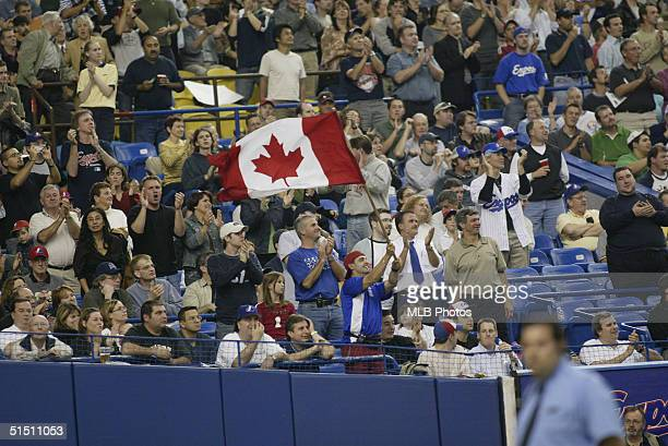 Montreal Expos fan waves a Canadien Flag during the final Expos home game ever at Olympic Stadium against the Florida Marlins on September 29 2004 in...