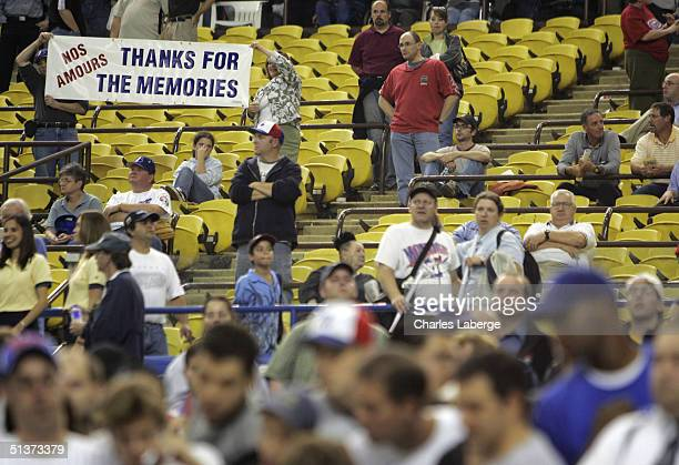 Montreal Expos fans hold a sign after the team's final home game ever against the Florida Marlins at Olympic Stadium September 29 2004 in Montreal...