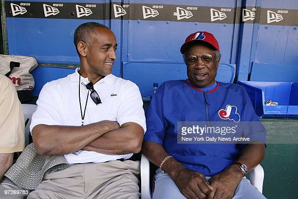 Montreal Expos' general manager and vice president Omar Minaya talks with Expos' manager Frank Robinson in the dugout during practice at Veterans...