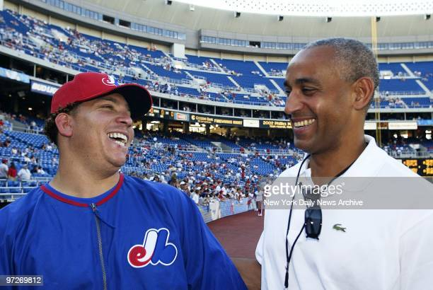 Montreal Expos' newlyacquired pitcher Bartolo Colon shares a laugh with Expos' general manager and vice president Omar Minaya during practice at...