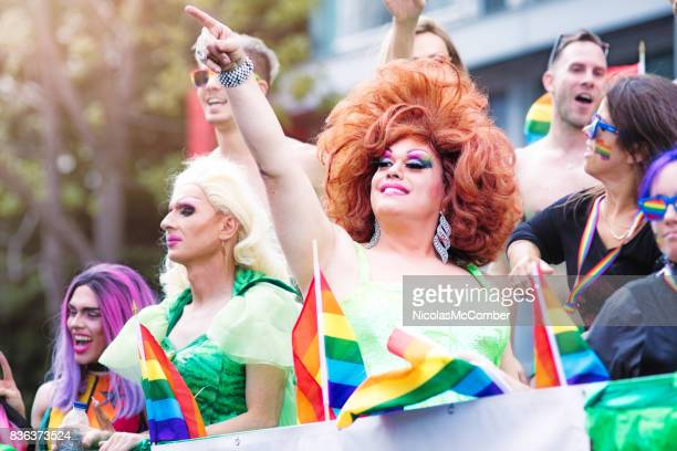 montreal gay pride parade drag queen performer pointing at the crowd from a float - crossdressing party stock photos and pictures