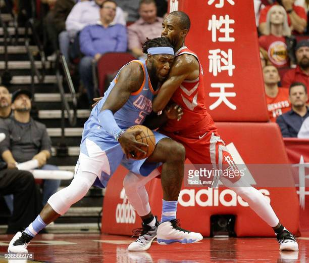 Montreal Harrell of the LA Clippers drives on Luc Mbah a Moute of the Houston Rockets at Toyota Center on March 15 2018 in Houston Texas NOTE TO USER...
