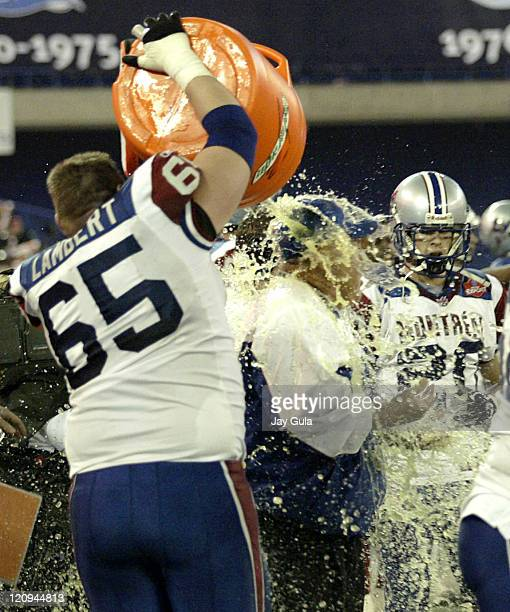 Montreal Head Coach Don Matthews is showered with Gatorade by Offensive Lineman Paul Lambert to celebrate Montreal's 3317 victory in the CFL East...