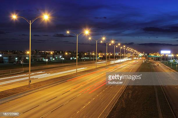 montreal illuminated highway at night - buzbuzzer stock pictures, royalty-free photos & images