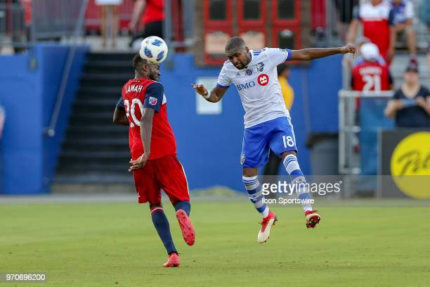 Montreal Impact defender Chris Duvall heads the ball past FC Dallas forward Roland Lamah during the soccer match between the Montreal Impact and FC...