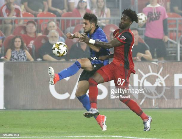 TORONTO ON SEPTEMBER 20 Montreal Impact defender Deian Boldor and Toronto FC forward Tosaint Ricketts battle for a ball as Toronto FC fall to the...