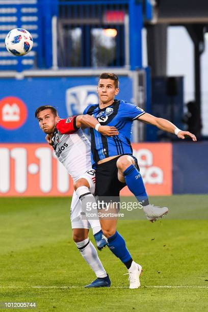 Montreal Impact defender Jukka Raitala and DC United midfielder Ulises Segura track the ball in the air during the DC United versus the Montreal...