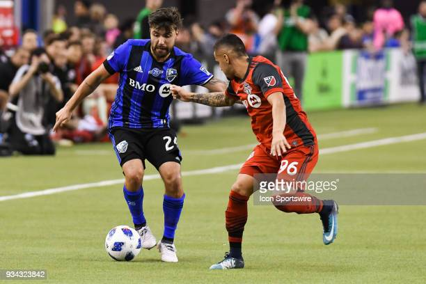 Montreal Impact defender Kyle Fisher ans Toronto FC forward Auro battle for control of the ball during the Toronto FC versus the Montreal Impact game...