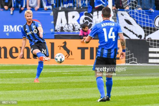 Montreal Impact defender Kyle Fisher passing the ball to Montreal Impact midfielder Adrian Arregui during the Columbus Crew FC versus the Montreal...