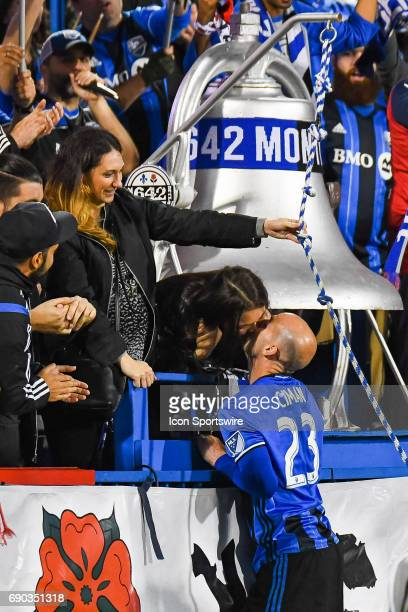 Montreal Impact defender Laurent Ciman jumping in the crowd after the win to kiss his wife in the stands during the Montreal Impact versus the...