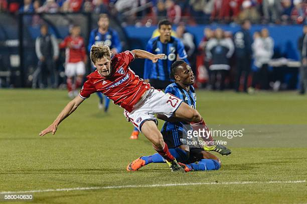 Montreal Impact forward Didier Drogba is challenged by FC Dallas defender Walker Zimmerman during the MLS match between the Montreal Impact and FC...