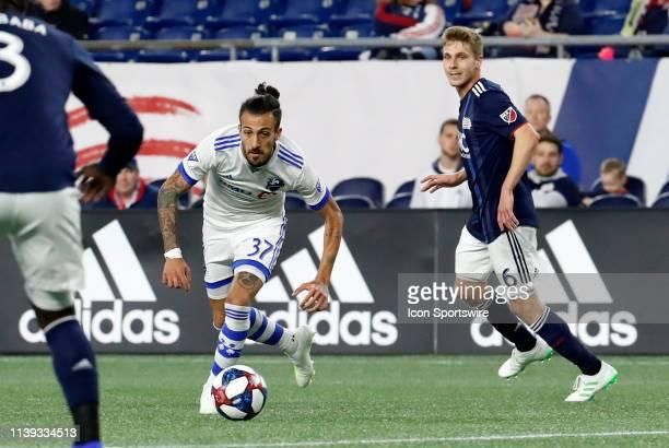 Montreal Impact forward Maximiliano Urruti eyes New England Revolution defender Jalil Anibaba after beating New England Revolution midfielder Scott...