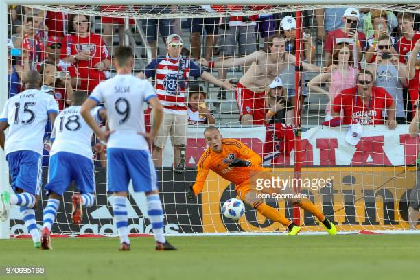 Montreal Impact goalkeeper Evan Bush attempts to stop a penalty kick during the soccer match between the Montreal Impact and FC Dallas on June 9 2018...