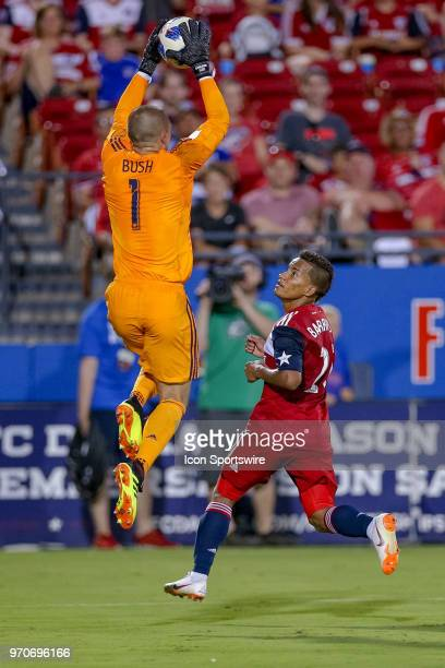 Montreal Impact goalkeeper Evan Bush comes out to beat FC Dallas midfielder Michael Barrios to the ball during the soccer match between the Montreal...