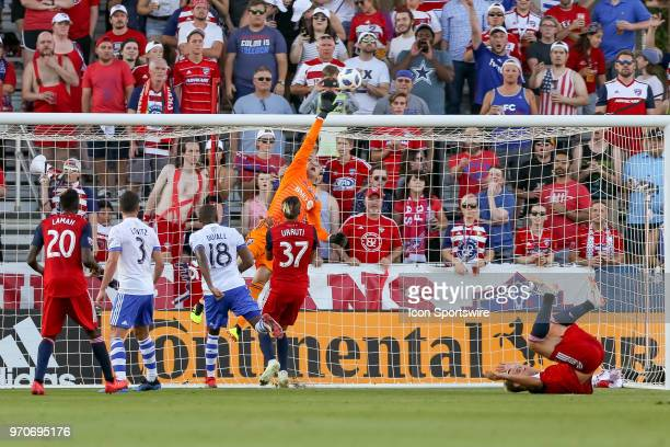 Montreal Impact goalkeeper Evan Bush leaps for a ball during the soccer match between the Montreal Impact and FC Dallas on June 9 2018 at Toyota...
